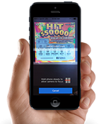 Hand holding a mobile device with the Texas Lottery app on it